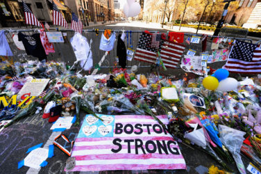 BOSTON, MA - APRIL 21: Items are placed by people visiting a makeshift memorial for victims near the site of the Boston Marathon bombings at the intersection of Boylston Street and Berkley Street two days after the second suspect was captured on April 21, 2013 in Boston, Massachusetts. A manhunt for Dzhokhar A. Tsarnaev, 19, a suspect in the Boston Marathon bombing ended after he was apprehended on a boat parked on a residential property in Watertown, Massachusetts. His brother Tamerlan Tsarnaev, 26, the other suspect, was shot and killed after a car chase and shootout with police. The bombing, on April 15 at the finish line of the marathon, killed three people and wounded at least 170. (Photo by Kevork Djansezian/Getty Images)